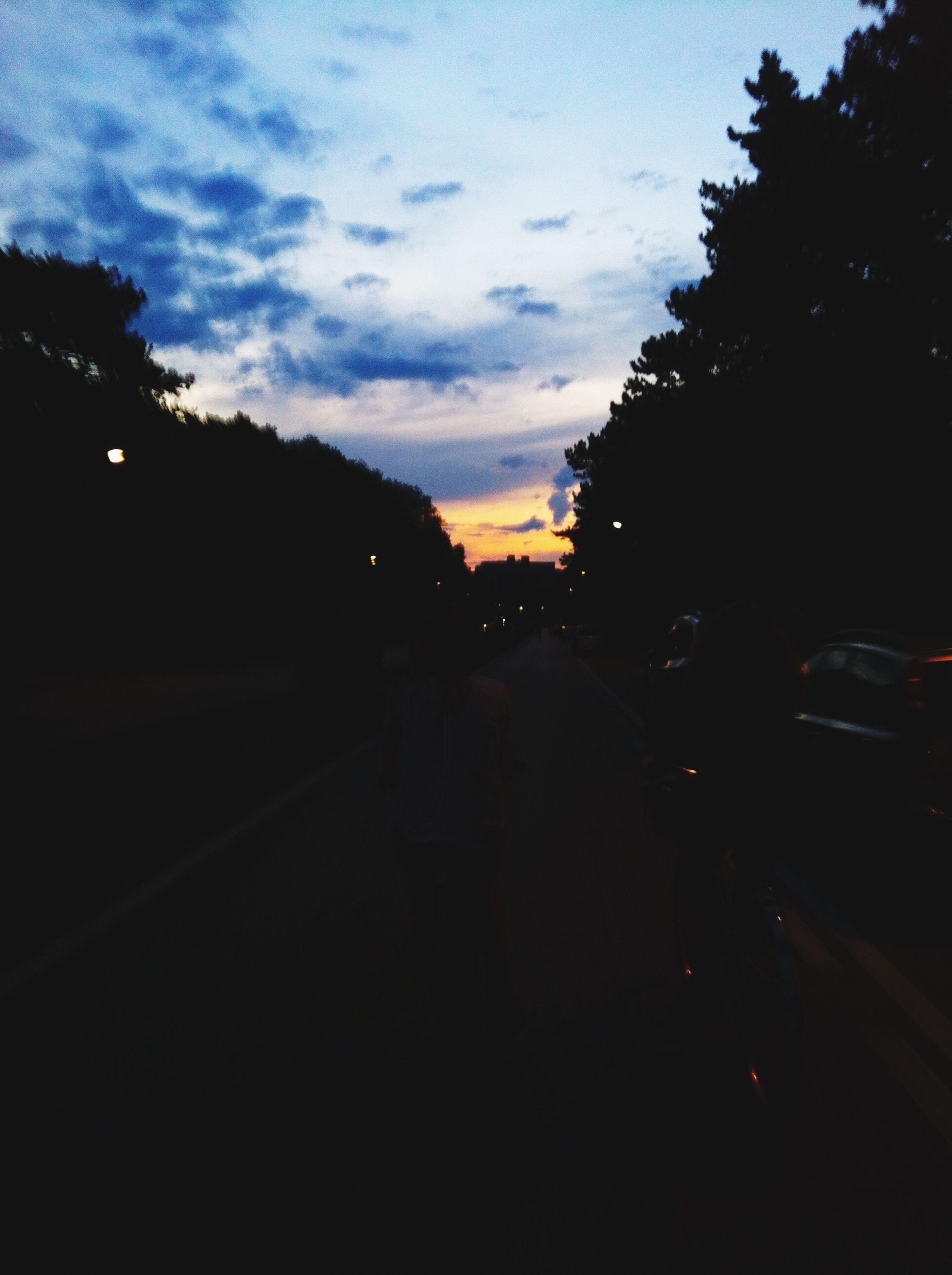 transportation, sunset, car, sky, silhouette, land vehicle, tree, street, mode of transport, road, cloud - sky, dusk, cloud, dark, outdoors, building exterior, city, nature, no people, travel