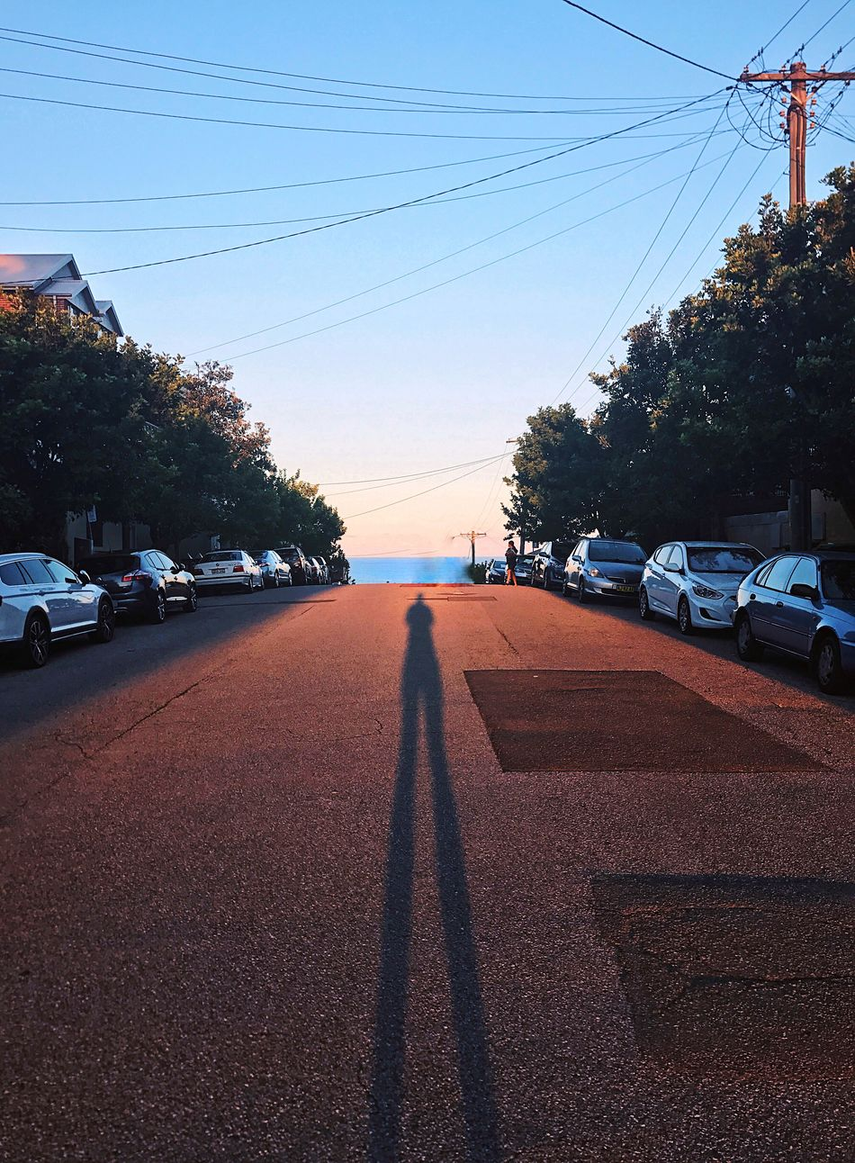 Arvo strolls Car Transportation Land Vehicle Road Cable Mode Of Transport Tree Street Electricity Pylon Sunset Outdoors One Person Sky Day Nature People Shadows & Lights EyeEmNewInHere EyeEmNewHere Sunset_collection Sunset Silhouettes Dusk Australia Beautiful Beach Life Break The Mold