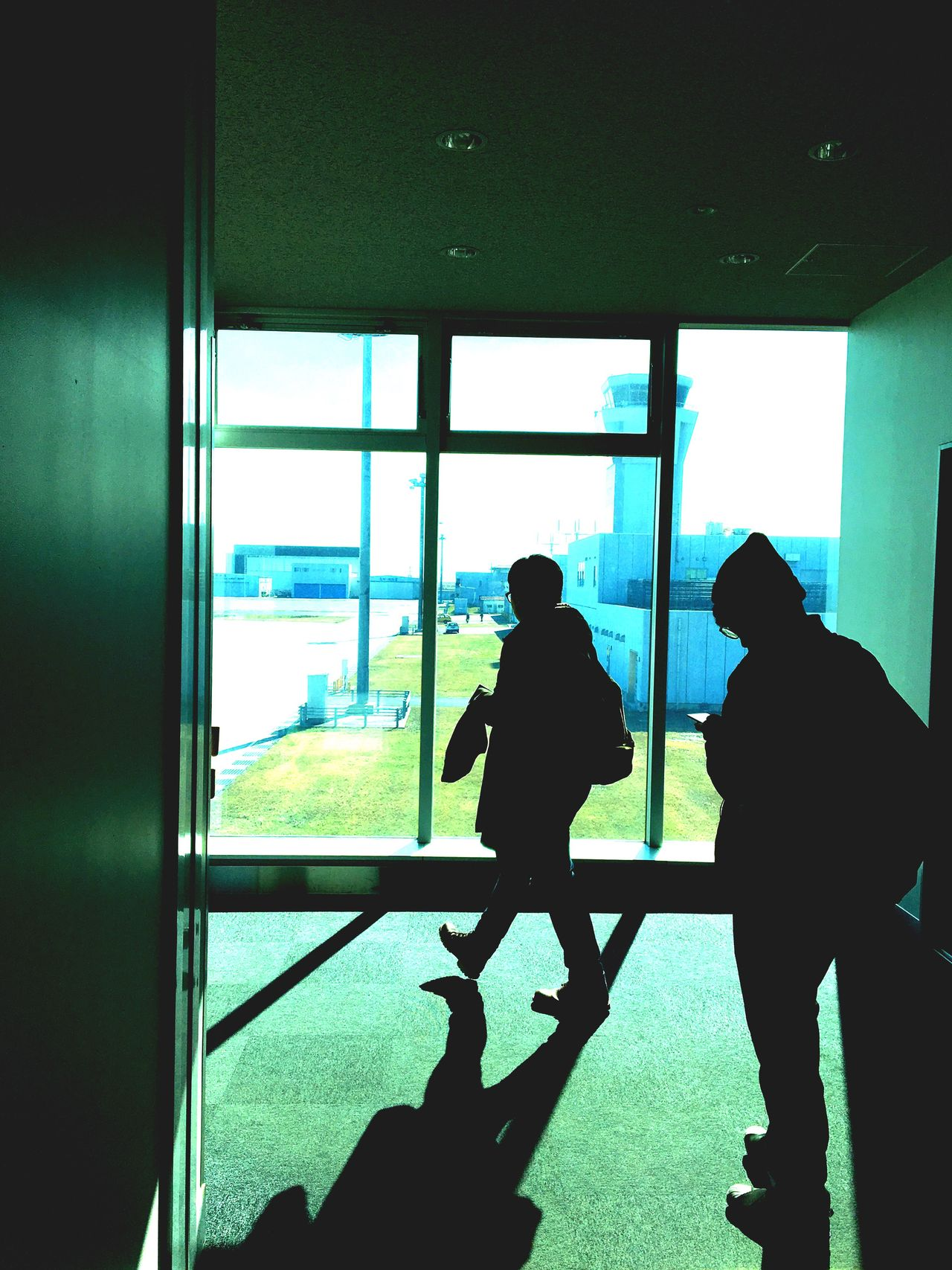 Window Men Indoors  Real People Silhouette Standing Two People Lifestyles Women Leisure Activity Day Airport Friendship Togetherness Only Men Adult Adults Only People Passenger Boarding Bridge Airport Terminal Kokura Kitakyushu Airport Kitakyushu Japan Vonvoyage