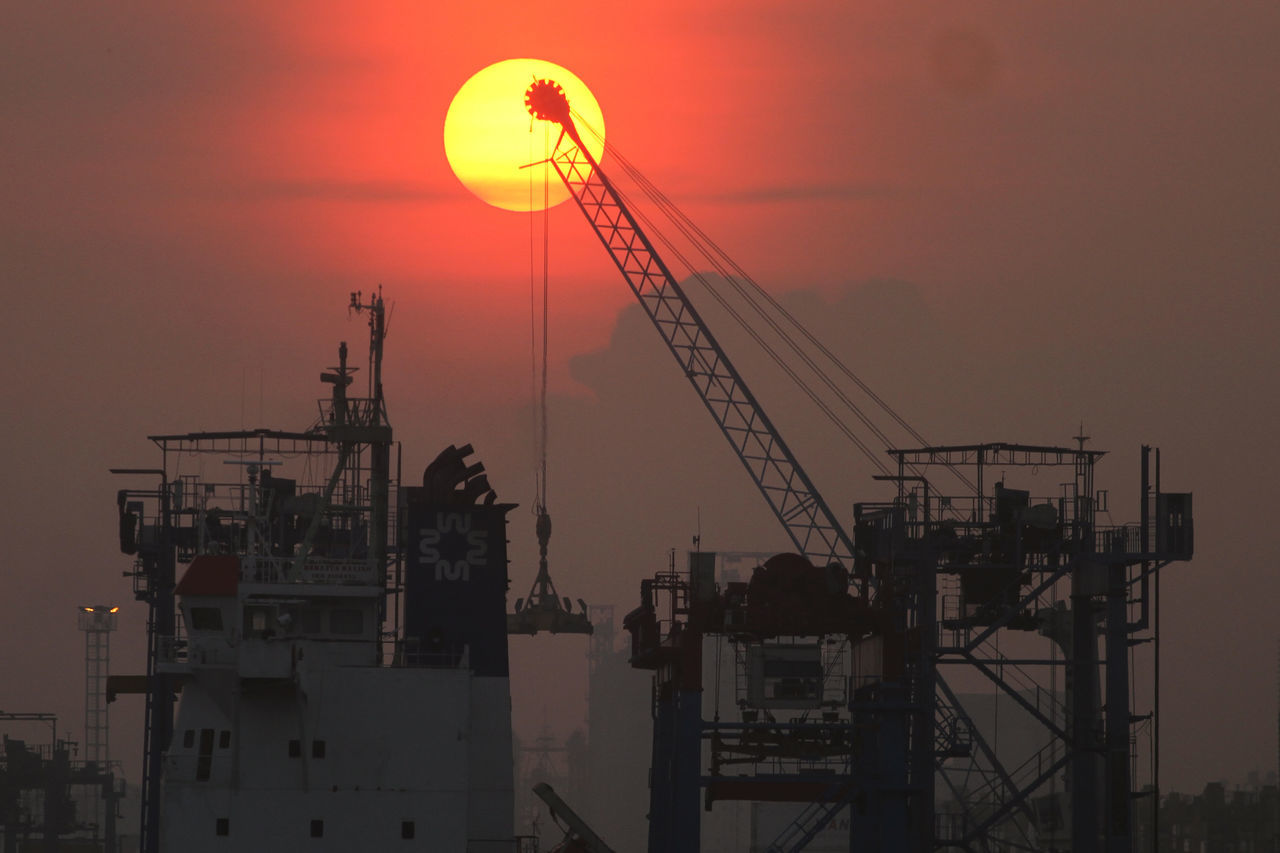 Tanjung Priok Harbour #harbour Architecture Building Exterior Construction Construction Industry Construction Site Crane Crane - Construction Machinery Development Fuel And Power Generation Industry Orange Color Silhouette Sky Sunset