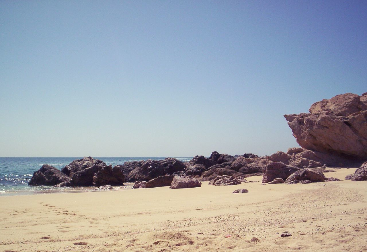 Sea Beach Sand Sky Horizon Over Water Clear Sky Outdoors Day No People Scenics Tranquil Scene Tranquility Nature Beauty In Nature Vacations Water Pacific Ocean Rocks In Water Rocks And Sea Rock Formation Rock - Object Coastal Feature EyeEmNewHere Mexico Copy Space