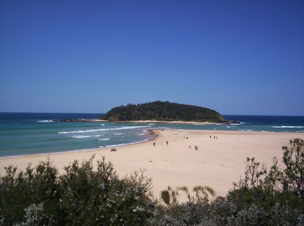 Lake Tabourie and 2 beaches at high tide, NSW, Australia. At low tide the island becomes an isthmus. Beach Blue Clear Sky Coastline Day Hgh Tide Holiday Horizon Over Water Island Isthmus Nature Non Urban Scene Outdoors Sea Seascape Shore Sky Surf Tourism View Water Waves
