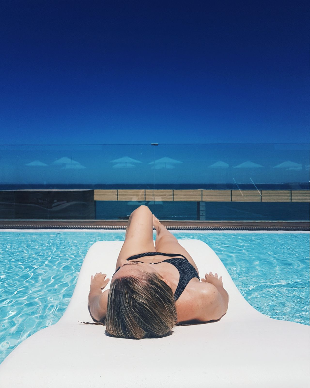 Bikini Swimming Pool One Woman Only Only Women Water Vacations Swimwear Summer Beauty One Person Adults Only Adult Sunbathing Young Adult Beautiful People Fashion Leisure Activity One Young Woman Only People Young Women Live For The Story