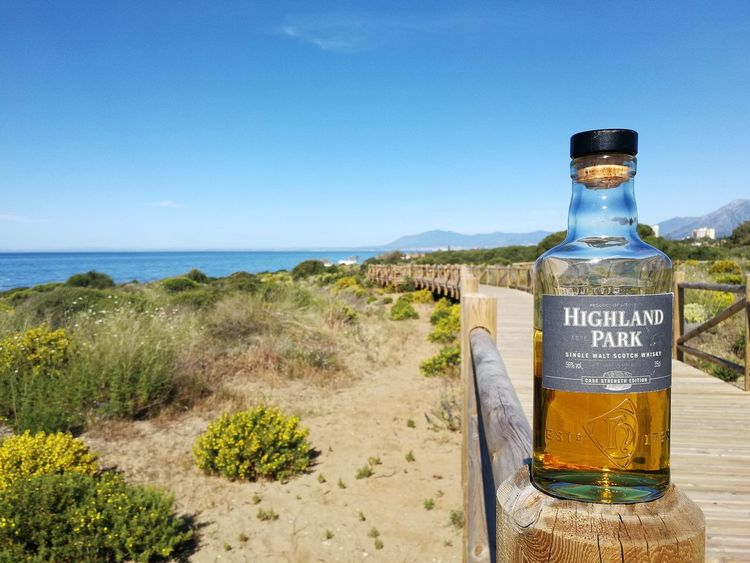 Walking. EyeEm Selects Sea Beach Water Sand Text Vacations Horizon Over Water Drink Sky No People Clear Sky Outdoors Nature Beauty In Nature Sommergefühle Bottle Whisky And Water Huawei P10 HighlandPark Whisky Whiskyviewhunting