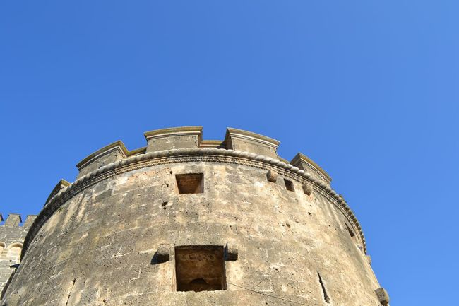 Architecture Blue Building Exterior Built Structure Castle Clear Sky Day Famous Place Fort Fortified Wall Fortress High Section History Low Angle View Medieval National Landmark No People Old Outdoors Salento Puglia Stone Material Tall - High The Past Torre Tower