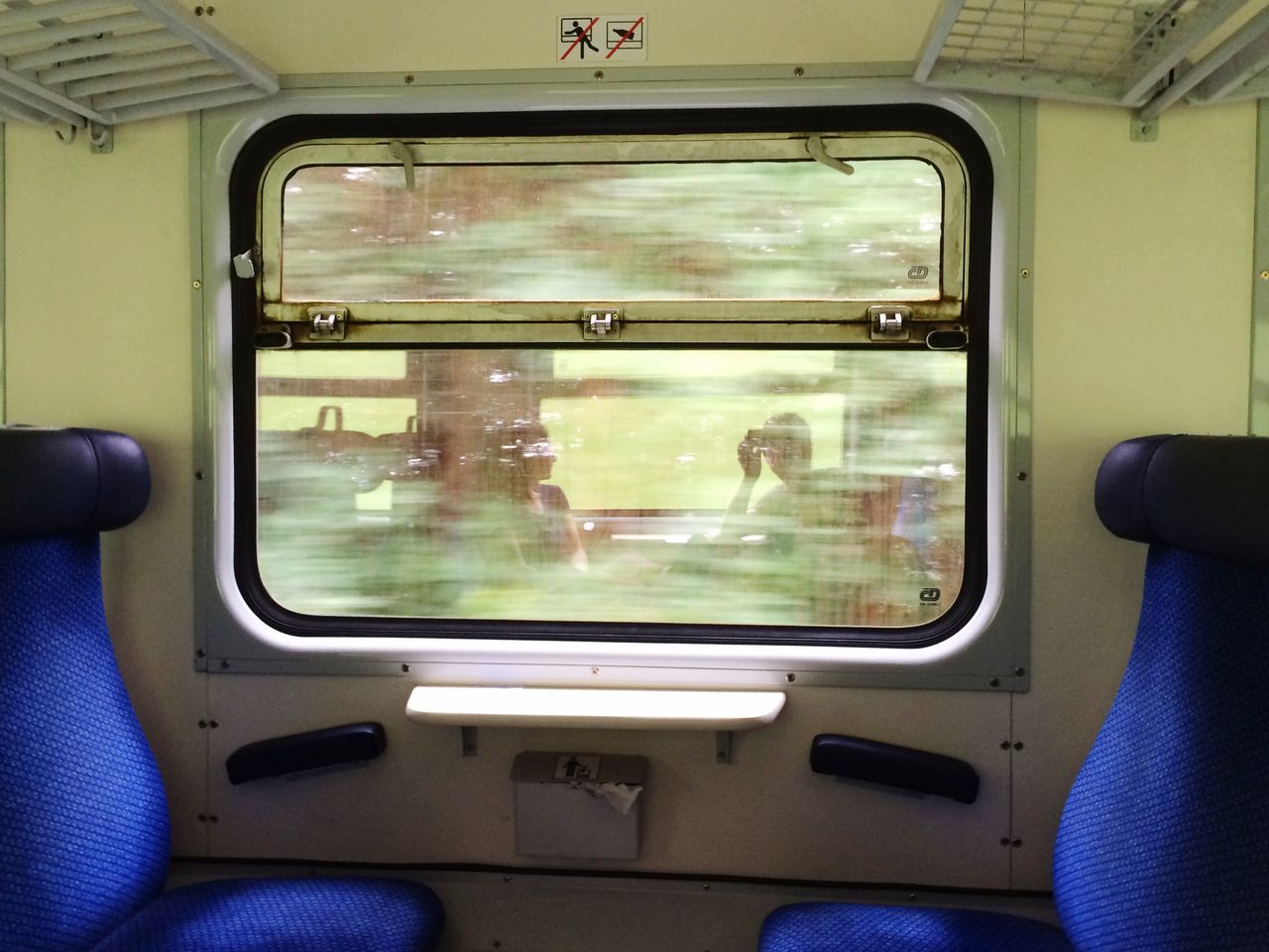 On the train in the Czech Republic. Photo by Tom Bland. Transportation Window Train Interior IPhoneography IPhone Europe Travel Traveling Travellers Travelling Travelers Adventure Exploring Czech Republic Couple Reflection Together Train Travel Journey Motion Memories Moment Train Car Vacations Holiday