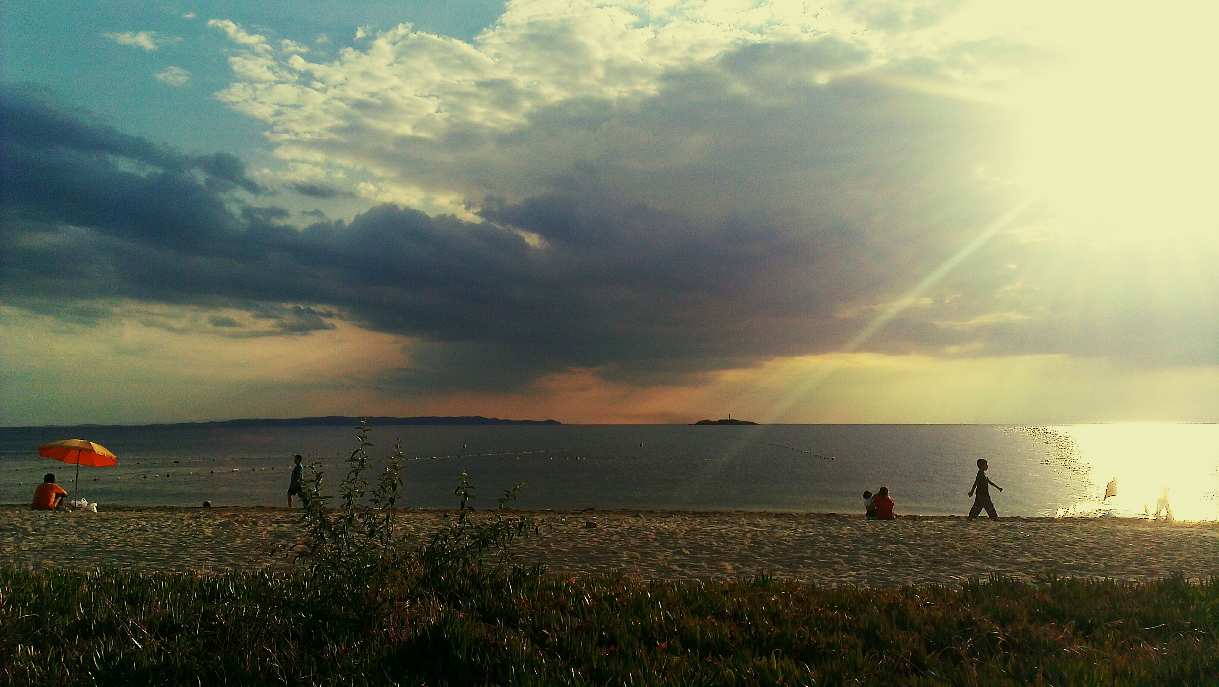 sky, water, sea, horizon over water, scenics, cloud - sky, leisure activity, beauty in nature, tranquil scene, beach, lifestyles, tranquility, nature, men, shore, sun, cloud, grass, sunset