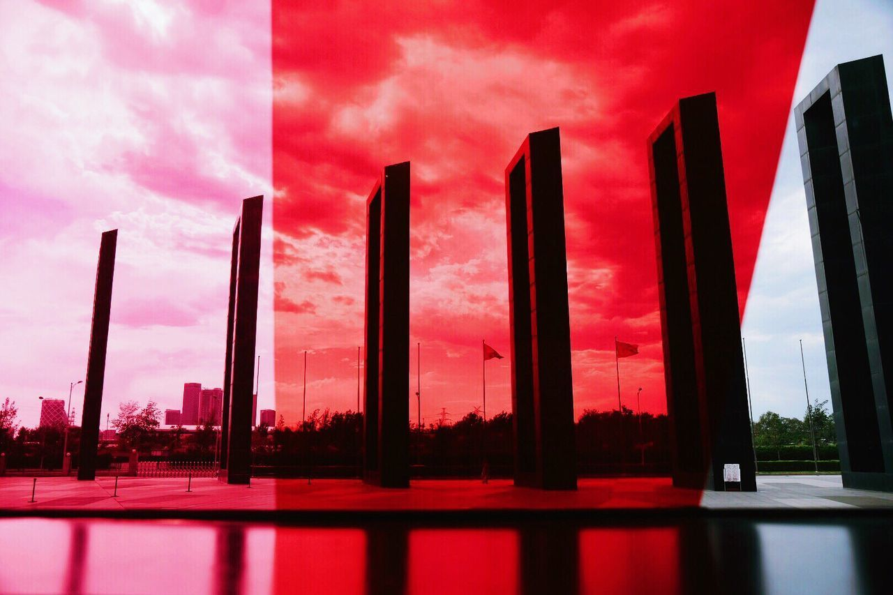 sky, architecture, building exterior, built structure, red, no people, cloud - sky, window, sunset, outdoors, day, water, city, nature