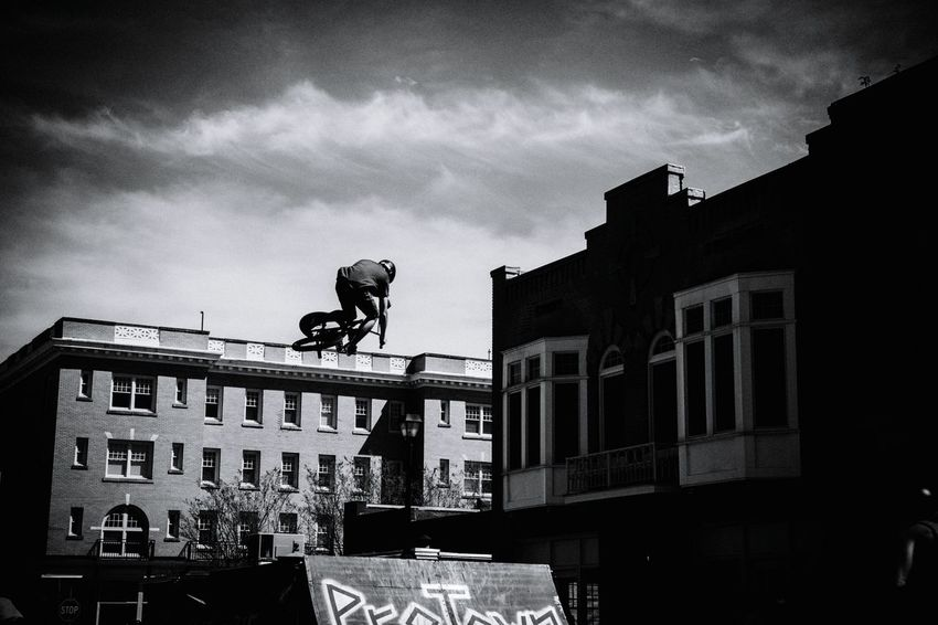 Streetphotography Bmx  VisualEffects Action Shot  Shot at a BMX show. Only did a color edit. I caught guy doing a stunt up in the air and looks as if he is riding the bike on the building. Pretty cool ☺