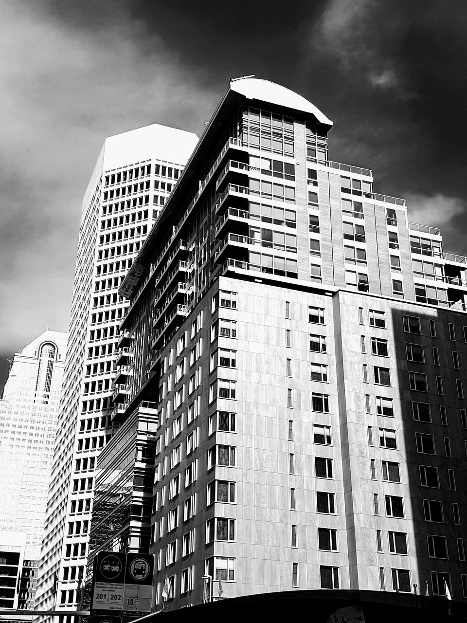 architecture, building exterior, low angle view, skyscraper, built structure, modern, sky, city, day, outdoors, cloud - sky, no people, travel destinations
