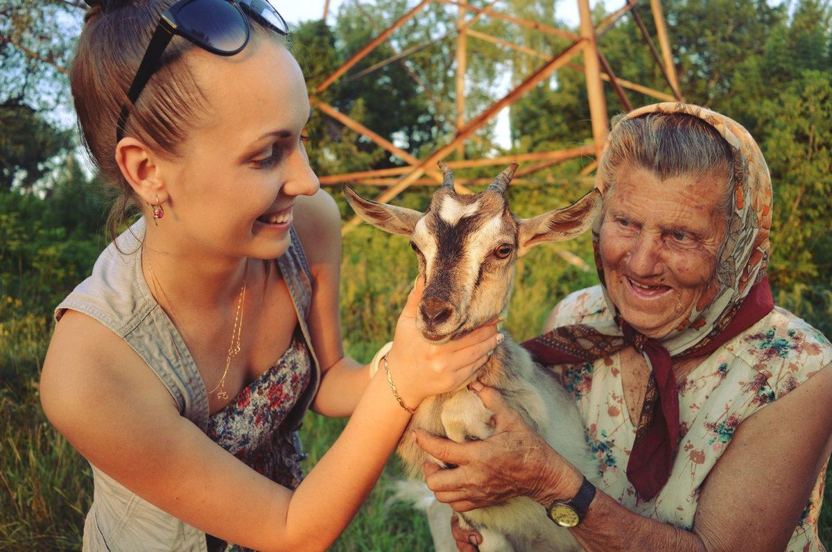 Animal Themes Friendship Goatling Happiness Nature Outdoors Portrait Smiling Young Animal Young Women