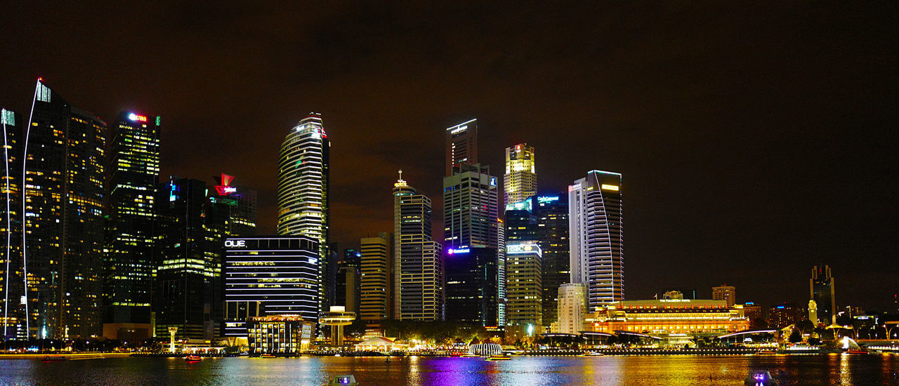 Architecture Building Exterior Built Structure City Cityscape Downtown District Financial District  Illuminated Modern Nautical Vessel Night No People Office Building Exterior Outdoors River Sky Skyscraper Tower Travel Destinations Urban Skyline Water Waterfront Yacht