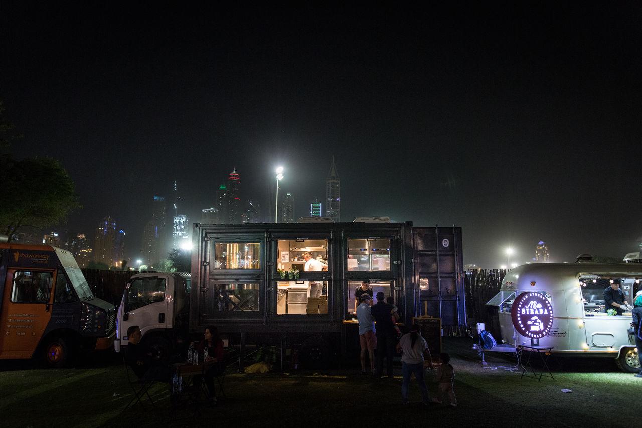 Adult City Container First Eyeem Photo Food Truck Food Trucks Illuminated Midnight Night Outdoors People Picoftheday Sky