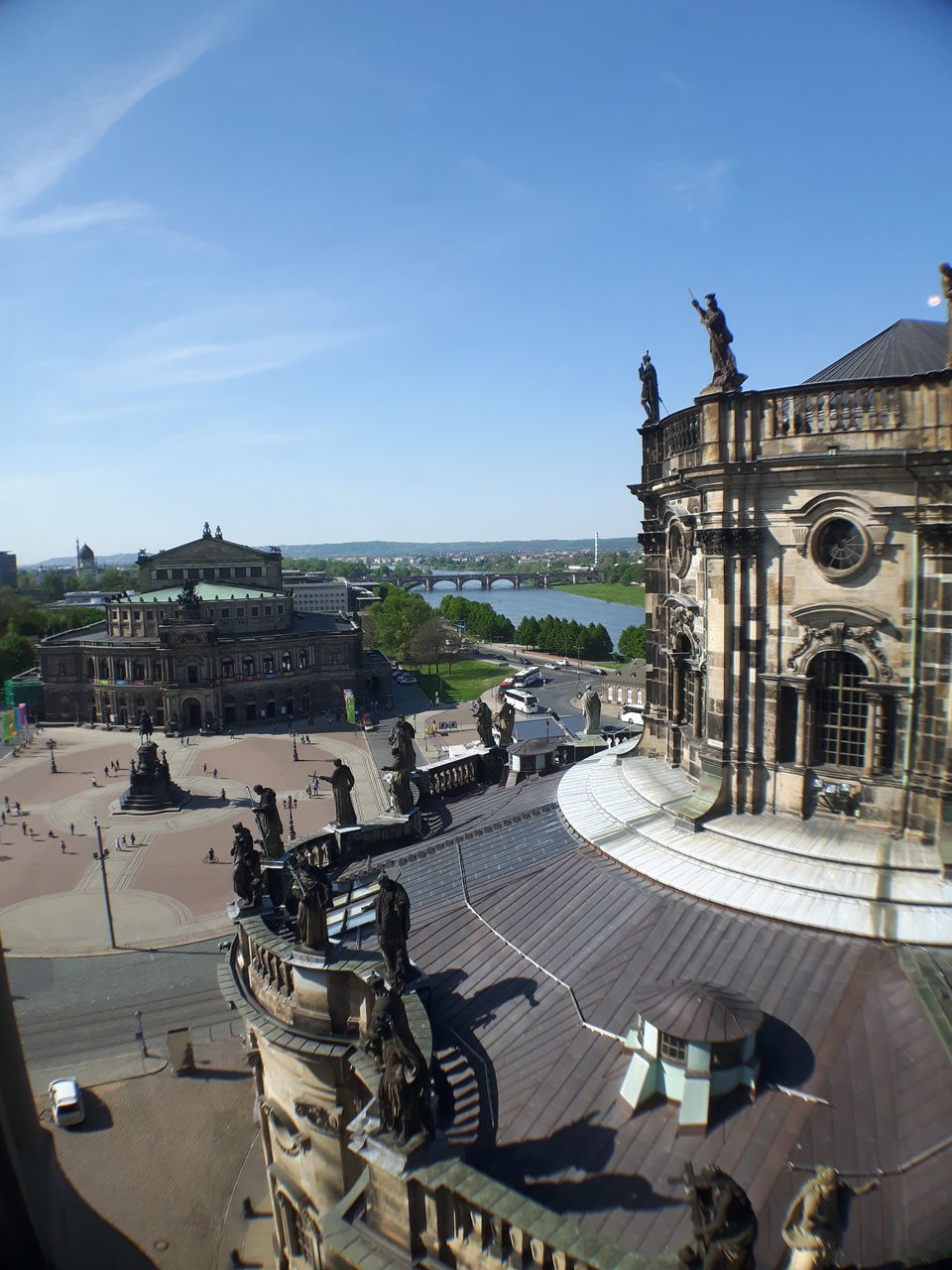 architecture, building exterior, built structure, history, sky, high angle view, incidental people, travel destinations, outdoors, city, day, sunlight, large group of people, blue, statue, cityscape, nature, ancient civilization, people