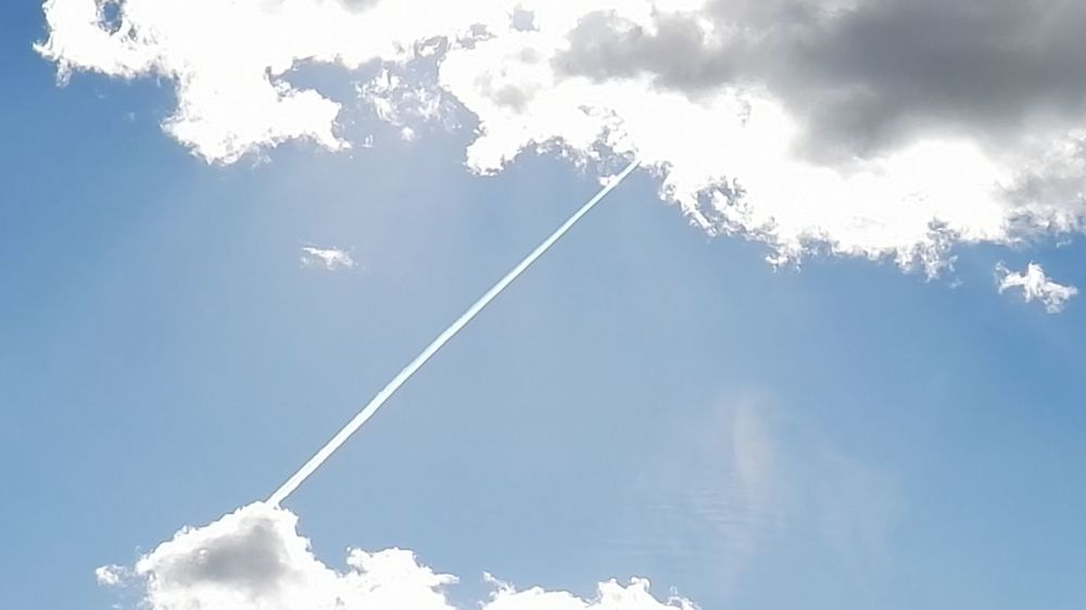 Airshow Beauty In Nature Blue Cloud - Sky Clouds Contrail Day Low Angle View Nature No People Outdoors Scenics Sky Slipstream Space Sun Trail Vapor Trail Vaportrail Vapourtrail White Color