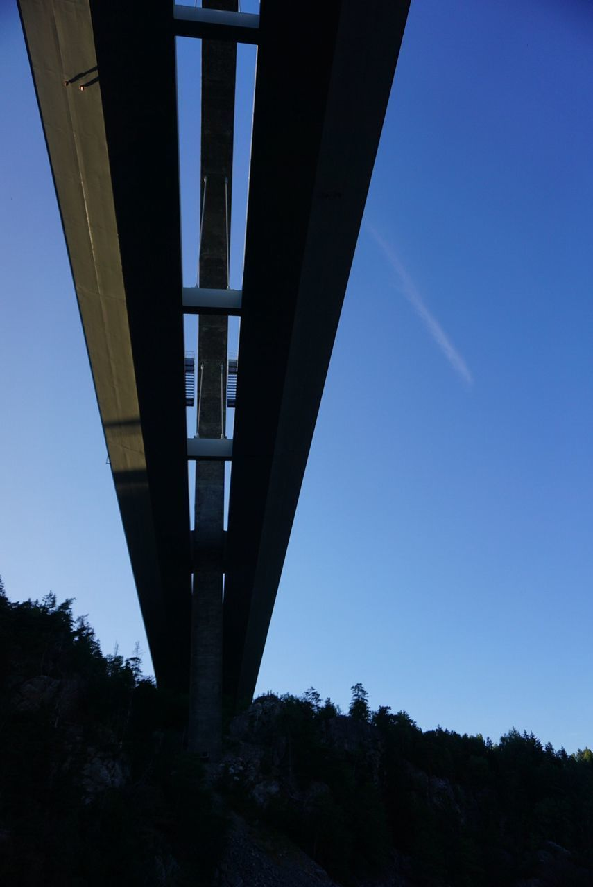 bridge - man made structure, connection, architecture, transportation, low angle view, clear sky, built structure, blue, tree, outdoors, below, bridge, no people, sky, day, underneath, nature