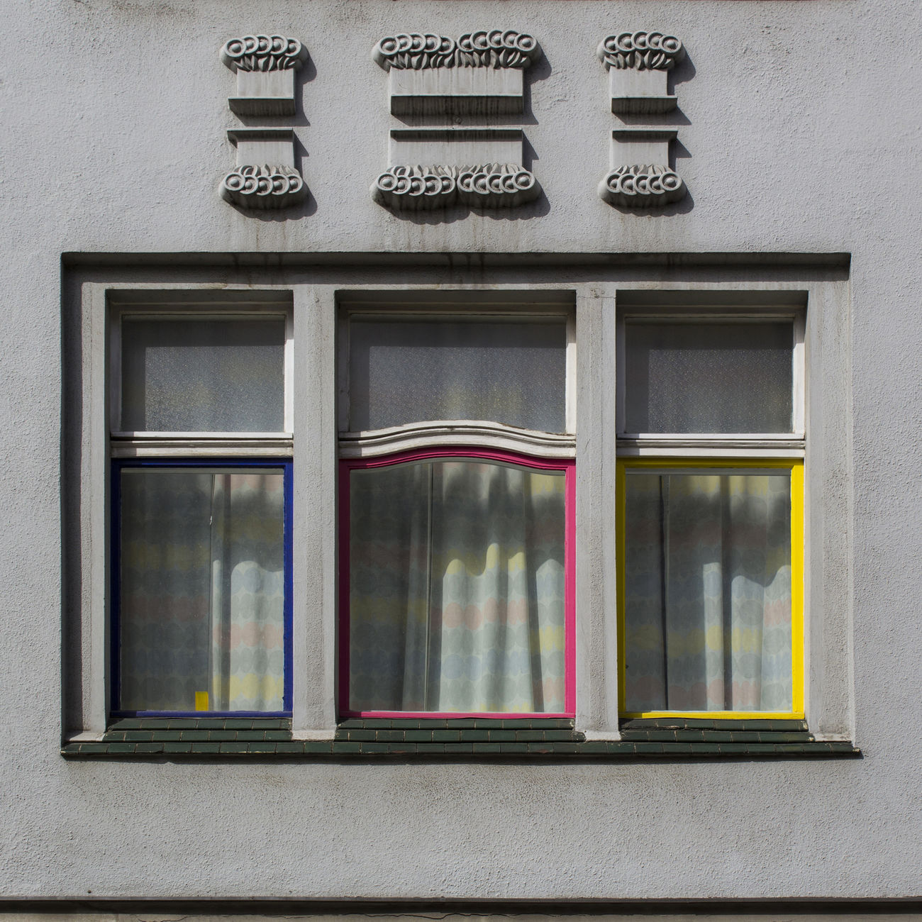 Berlin's Details. FILIPPI GIULIA PHOTOGRAPHY. Architecture Berlin Building Building Exterior Canon Colors Curtain Day Decoration Details Germany Glass Grey House Light And Shadow Multi Colored No People Outdoors Pattern Photographer Street Streetphotography Sun Transparent Window