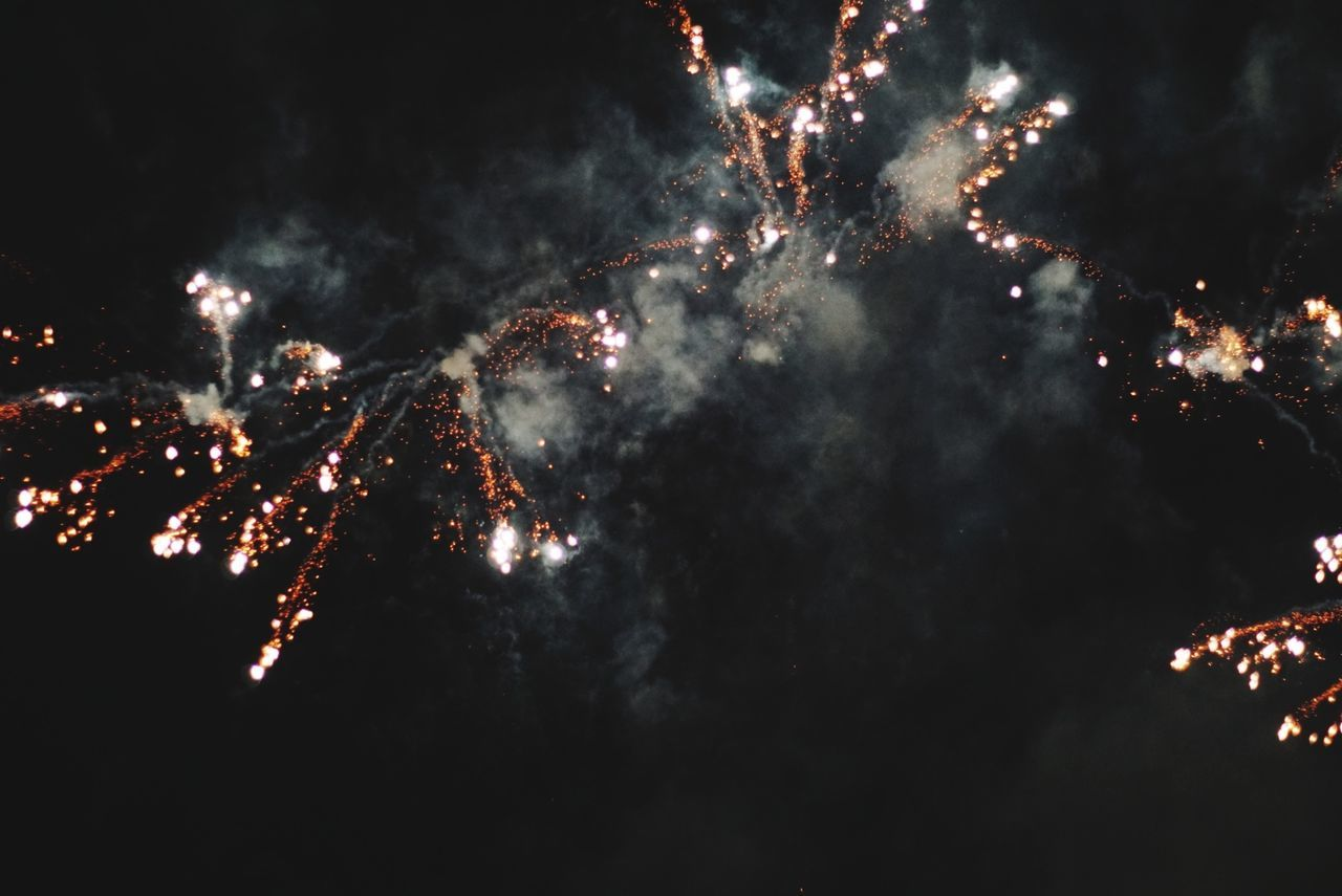 firework display, night, firework - man made object, celebration, exploding, event, outdoors, long exposure, low angle view, arts culture and entertainment, smoke - physical structure, glowing, no people, illuminated, firework, sky, motion
