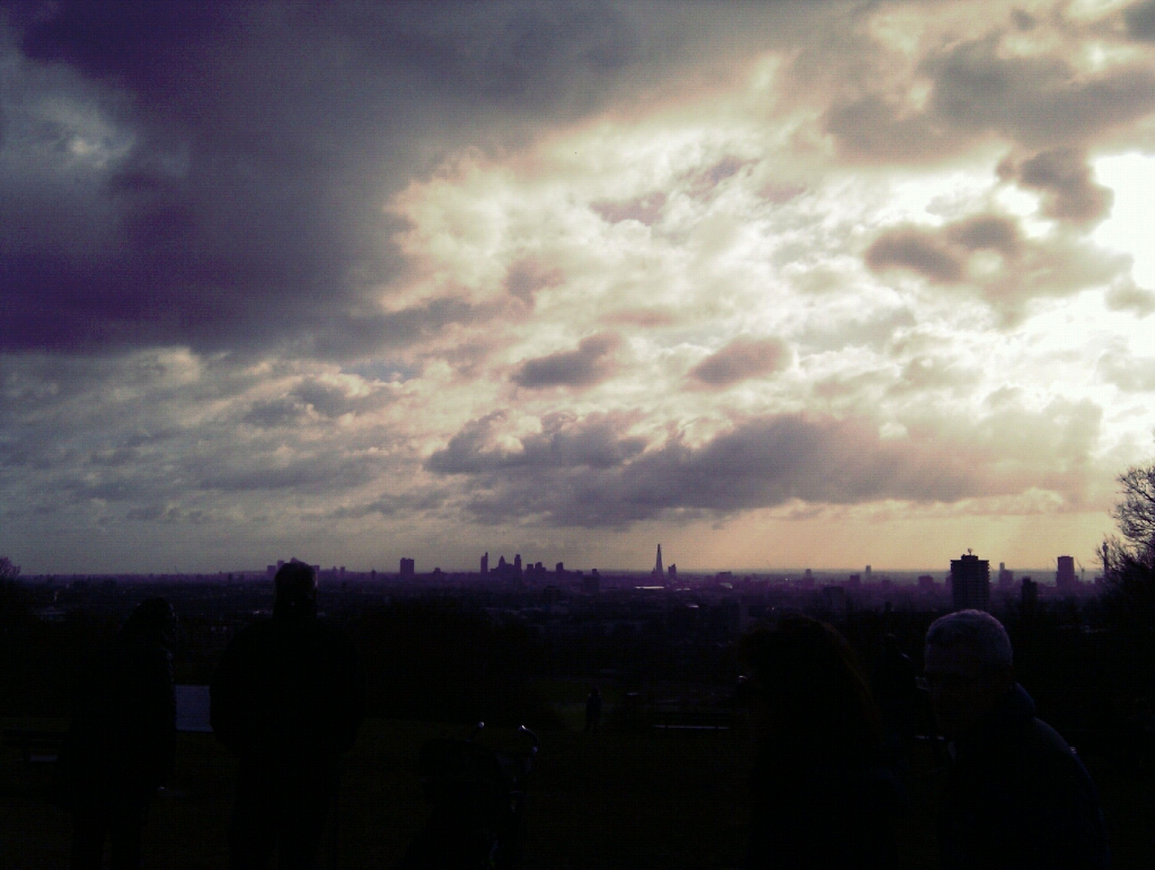 sky, cloud - sky, silhouette, men, cloudy, building exterior, built structure, lifestyles, architecture, city, leisure activity, person, dusk, cloud, weather, sunset, large group of people, cityscape, overcast