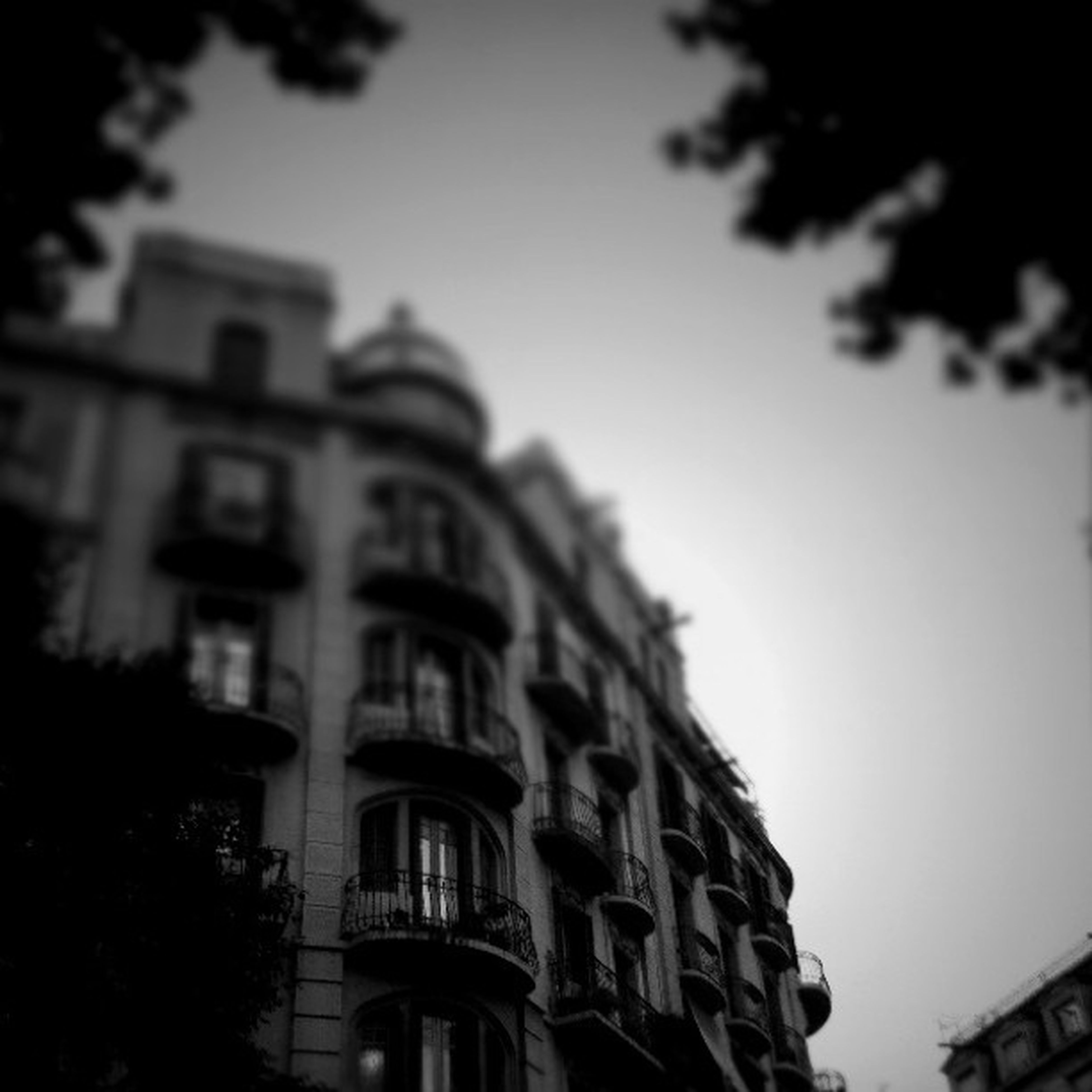 architecture, building exterior, built structure, low angle view, window, building, residential structure, sky, residential building, city, clear sky, house, outdoors, tree, no people, day, high section, dusk, balcony, facade
