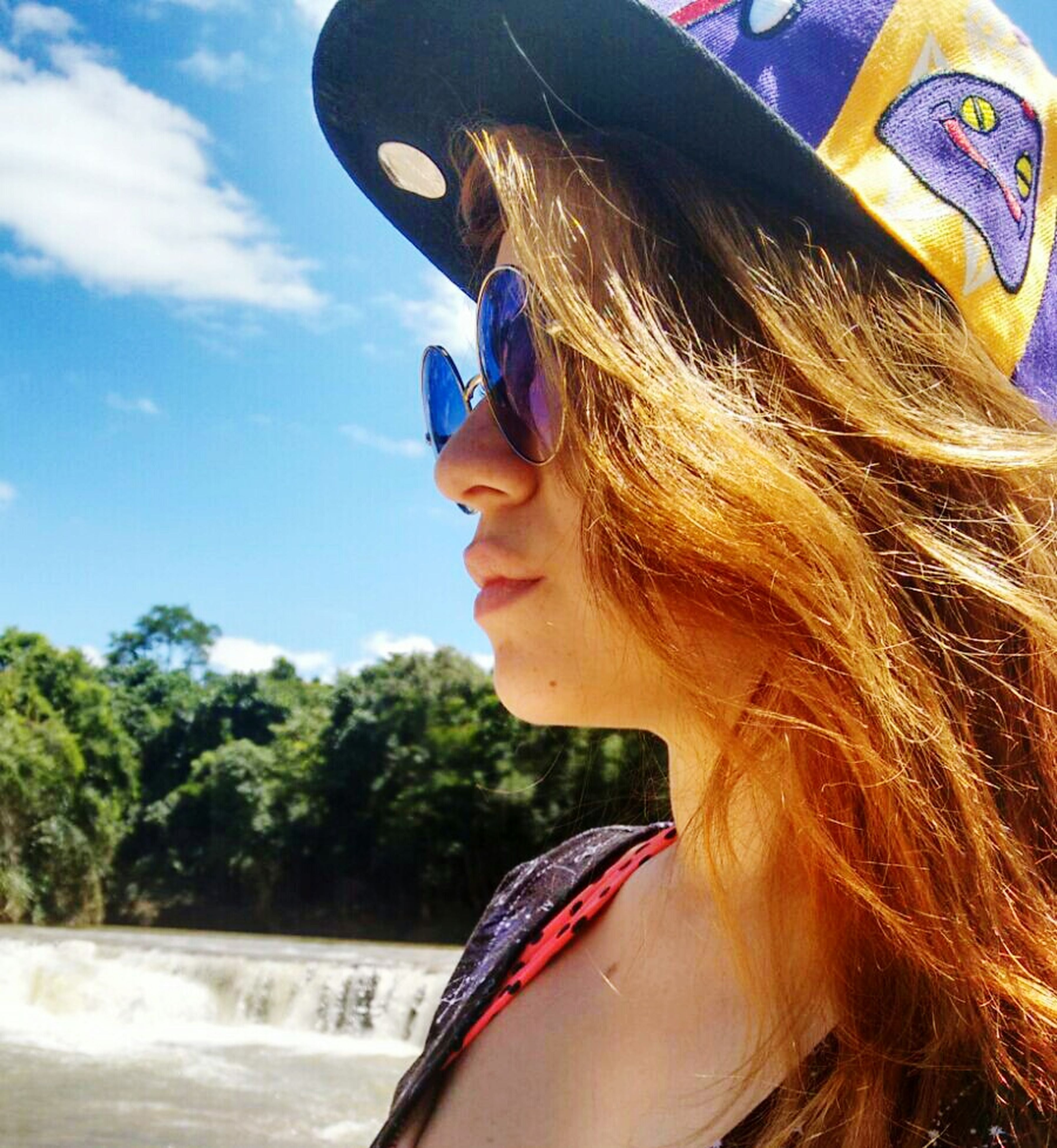 lifestyles, leisure activity, young adult, sunglasses, person, headshot, young women, close-up, day, part of, holding, cropped, tree, long hair, transportation, outdoors, sunlight, side view