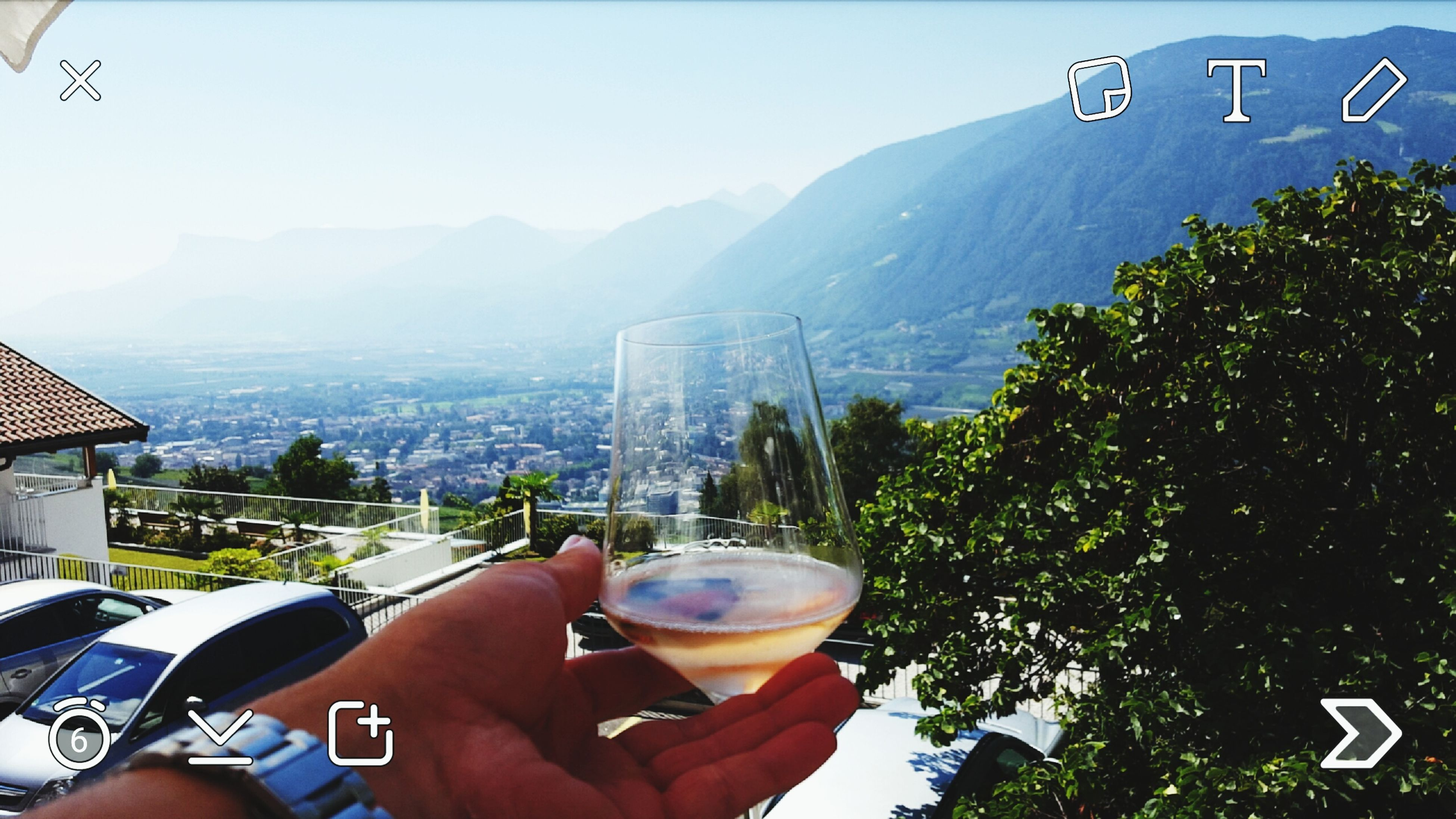 mountain, food and drink, lifestyles, leisure activity, drink, tree, part of, person, personal perspective, refreshment, mountain range, men, cropped, holding, day, unrecognizable person, freshness, clear sky