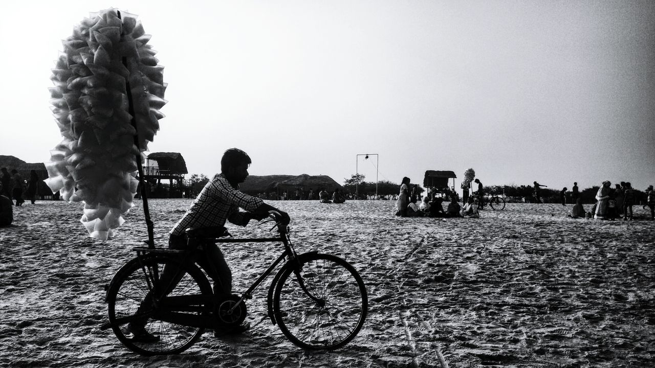 Beach Bicycle Real People Sky Outdoors Cycling Pushing A Bicycle Man Pushing Bike Man Cycling Seascape Sea And Sky Sea Shore Seaside Children