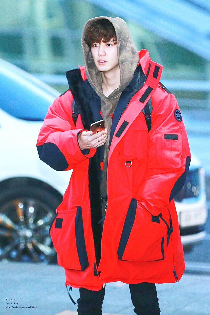 young adult, outdoors, day, young women, wireless technology, car, jacket, one person, winter, holding, communication, using phone, warm clothing, snow, lifestyles, standing, cold temperature, women, technology, city, portrait, one young woman only, adult, time, adults only, people