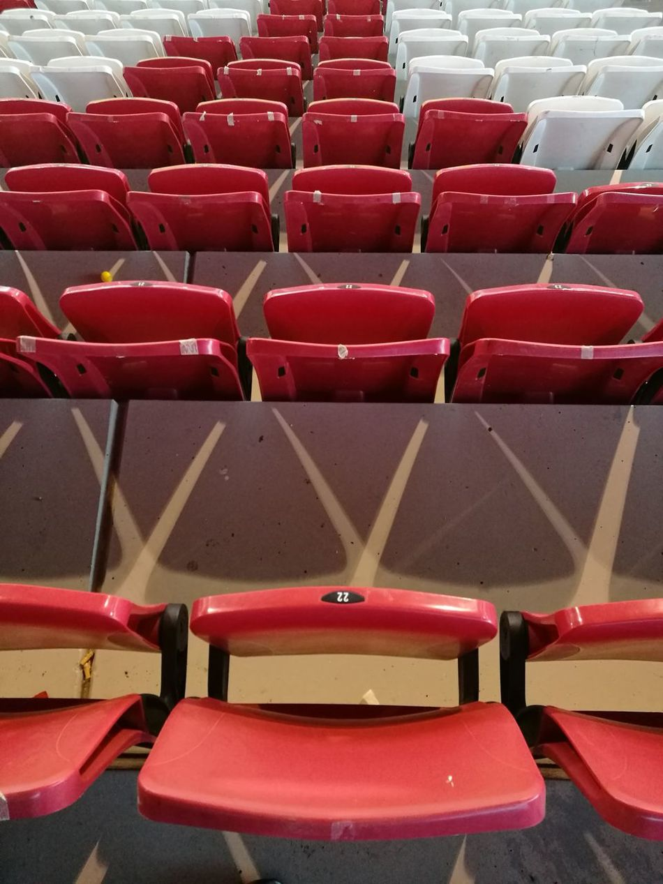 Red Seat Chair In A Row Auditorium Empty Indoors  Arts Culture And Entertainment Stadium Stadium Seating Football Football Stadium Futebol Football Time  Soccer Stadium Soccergame No People Empty Chair Empty Seats Empty Stadium