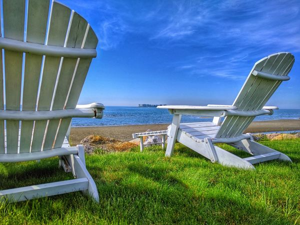Beach Beauty In Nature Blue Chair Day Grass Horizon Over Water Nature No People Outdoors Relaxation Sand Scenics Sea Sky Sunlight Tranquil Scene Tranquility Vacations Water