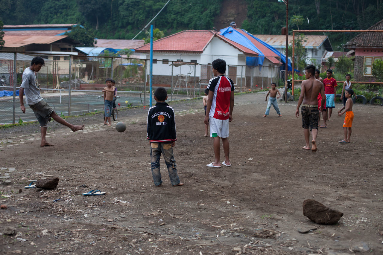 real people, playground, medium group of people, childhood, boys, built structure, education, lifestyles, full length, building exterior, day, men, playing, outdoors, architecture, tree, people, adult