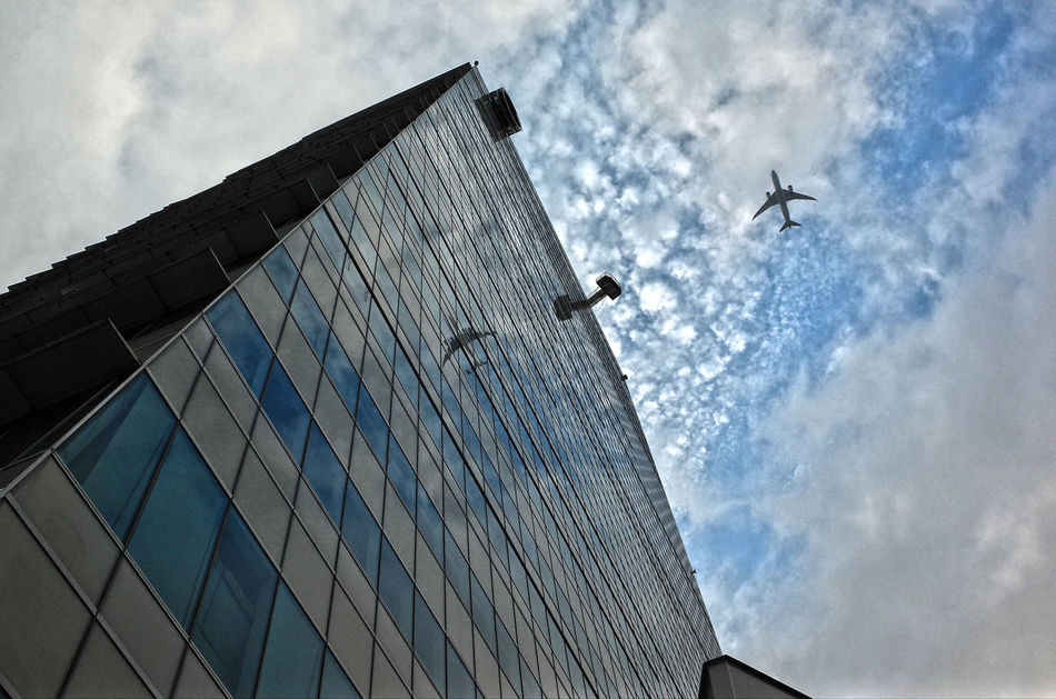 Air Plane Aircraft Airplane Airshow Architecture Cloud - Sky Curtain Walls Day Fighter Plane Flying Low Angle View Mid-air No People Outdoors Reflection_collection Sky