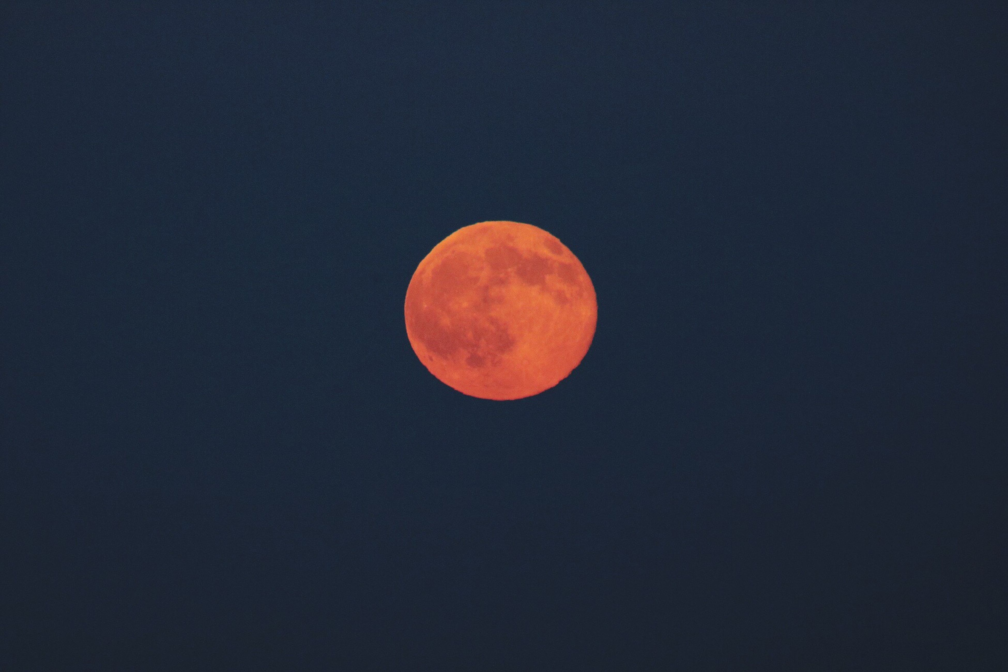 moon, copy space, low angle view, scenics, full moon, clear sky, circle, tranquility, astronomy, beauty in nature, tranquil scene, night, planetary moon, sky, nature, idyllic, red, no people, dark, orange color
