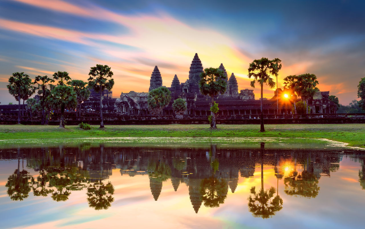 Angkor Wat at sunrise, famous temple at Siem Reap, Cambodia. Angkor Wat Architecture Beauty In Nature Building Exterior Built Structure Cambodia Cloud - Sky Day Grass Nature No People Outdoors Reflection Scenics Siem Reap Sky Sunrise Tranquility Travel Destinations Tree Water