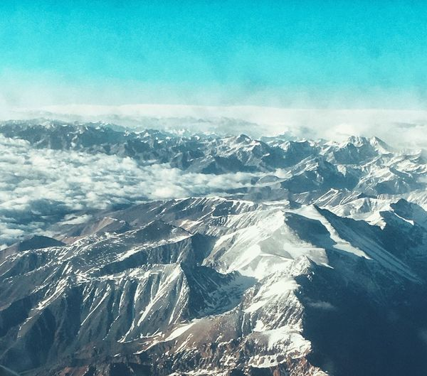 Mountain Season  Scenics Tranquil Scene Snow Cold Temperature Mountain Range Beauty In Nature Aerial View Majestic Blue Non-urban Scene Physical Geography White Color Idyllic Dramatic Landscape Tranquility Travel Destinations Tourism