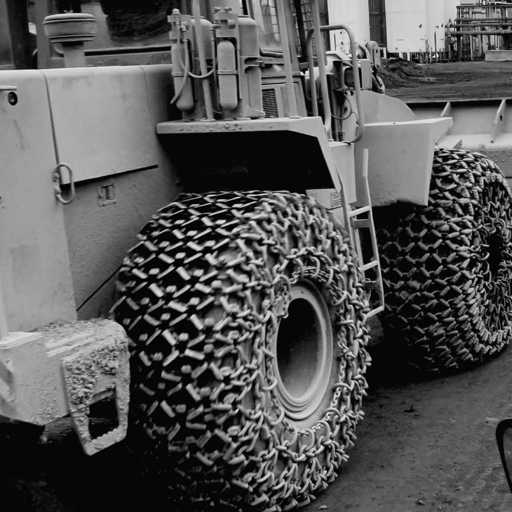 EyeEmNewHere Transportation Land Vehicle Mode Of Transport Car Day No People Outdoors Sky Tire Chains Tire Chains Traction Tractor Industry Steel Mill Loader Slag