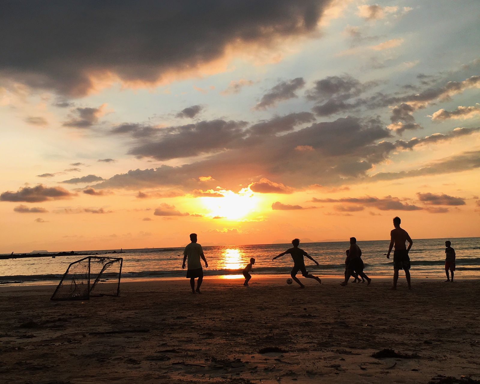 beach sunset sea sand Nature beauty in Nature water orange color scenics sky Silhouette lifestyles leisure activity net - sports equipment horizon over water playing full length Vacations enjoyment outdoors The Street Photographer - 2017 EyeEm Awards Live for the Story Connected by Travel