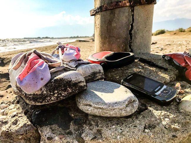 Beach Sand Day Outdoors Sea Sky No People Sand Pail And Shovel Water Shoes Socks Dogwalk Walking Telephone Old Complicated Kumsal Yürüyüş Gezinti Ayakkabı Telefon Lost In The Landscape Be. Ready.