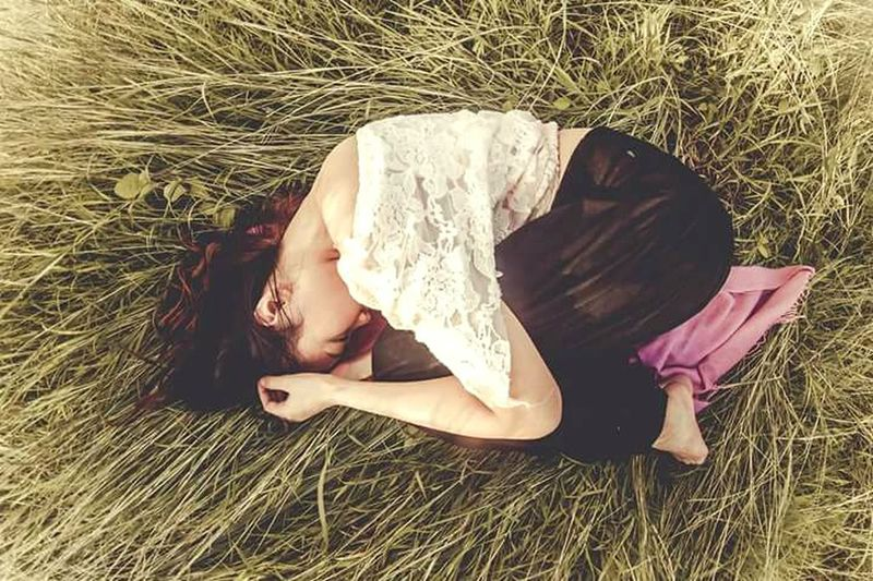 Lying Down Only Women One Woman Only Nature Day Emotions Emotional Photography EyeEm Best Shots One Young Woman Only Young Adult One Person Grass Outdoors Relaxation Emotional Photos Photography In Motion High Angle View First Eyeem Photo Long Hair Women Conceptual Photography