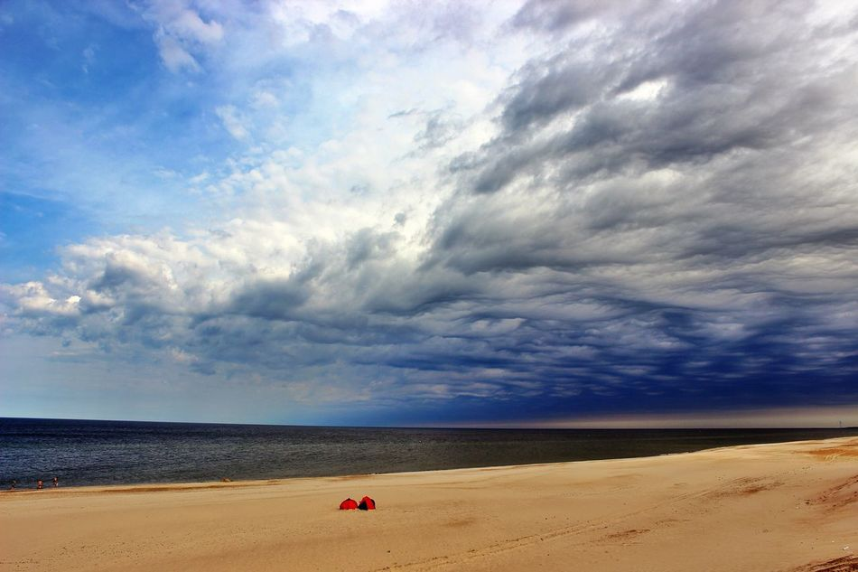 Huge beach in Denmark with a few campers awaiting the storm.My Best Photo 2014 Sky_collection Life Is A Beach Melancholic Landscapes Protecting Where We Play Edge Of The World Landscapes With WhiteWall The KIOMI