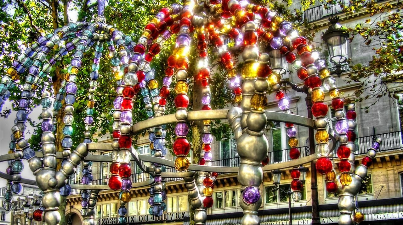 architecture, low angle view, built structure, building exterior, decoration, hanging, illuminated, religion, tradition, multi colored, place of worship, spirituality, christmas, celebration, christmas decoration, cultures, lighting equipment, christmas tree, art and craft, lantern