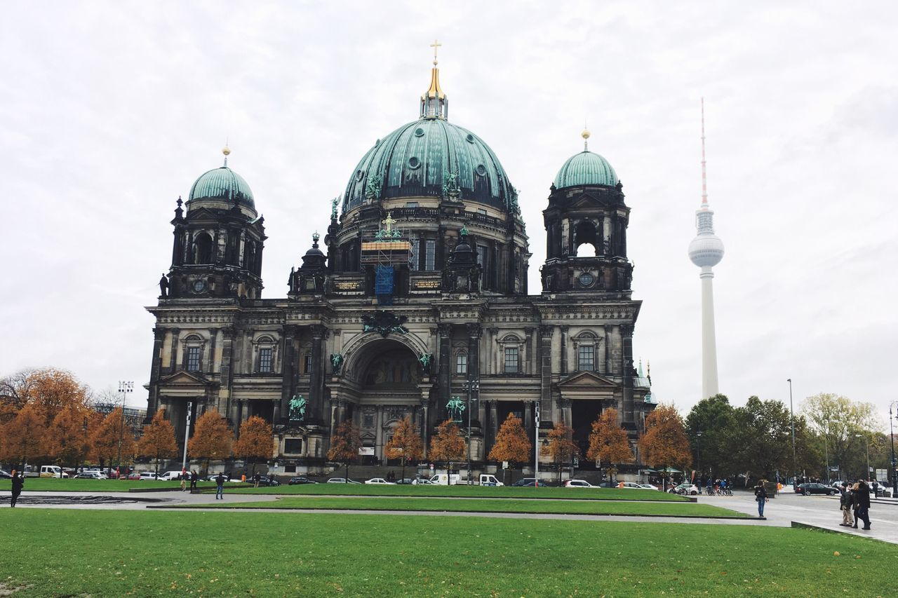 Berlin's museum and tv tower Architecture Building Exterior Built Structure Dome Religion Berlin Germany Green Color Travel Destinations Place Of Worship Travel Spirituality Tourism Outdoors City Cloud - Sky Grass City Life Real People Large Group Of People Day