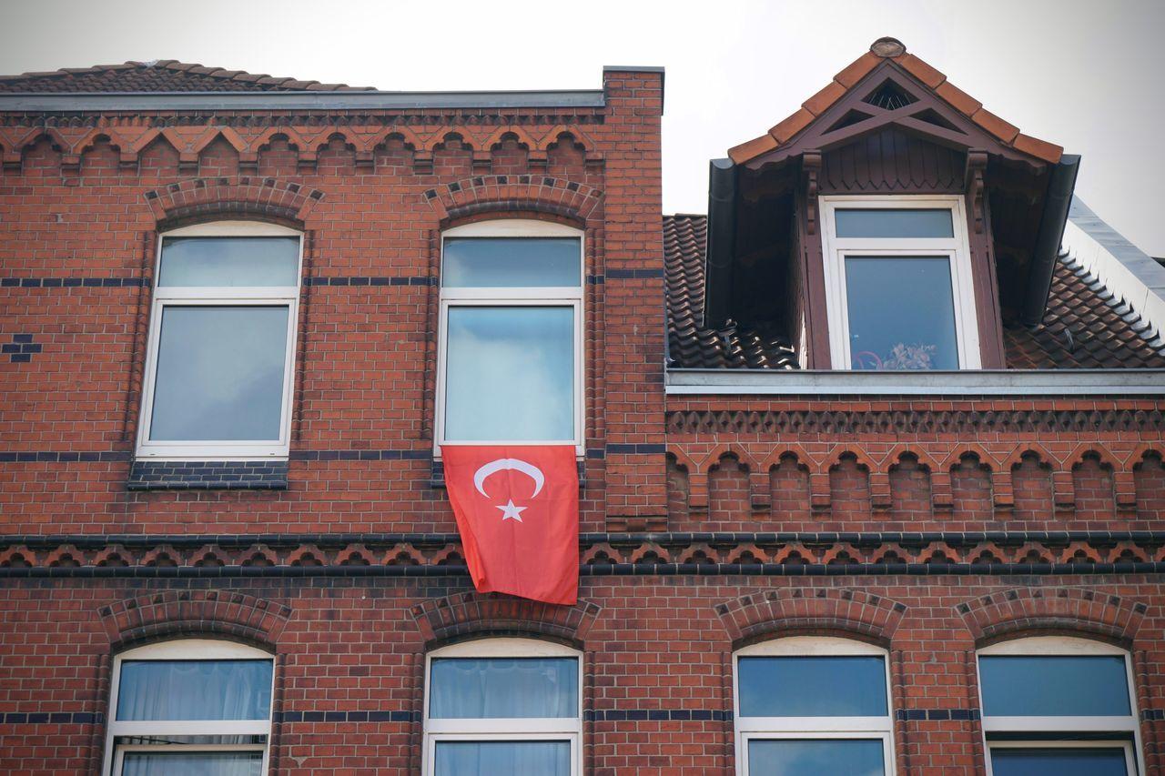 Low Angle View Of Turkish Flag On Window