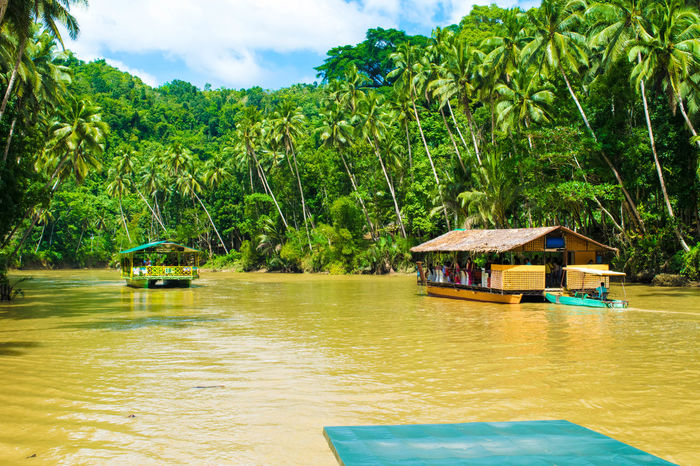 Beauty In Nature Boat Bohol Philippines Calm Cloud Cloud - Sky Day Green Color Growth Idyllic Mountain Nature No People Non-urban Scene Outdoors Philippines Remote Rippled Scenics Sky Tranquil Scene Tranquility Tree Vacations Water