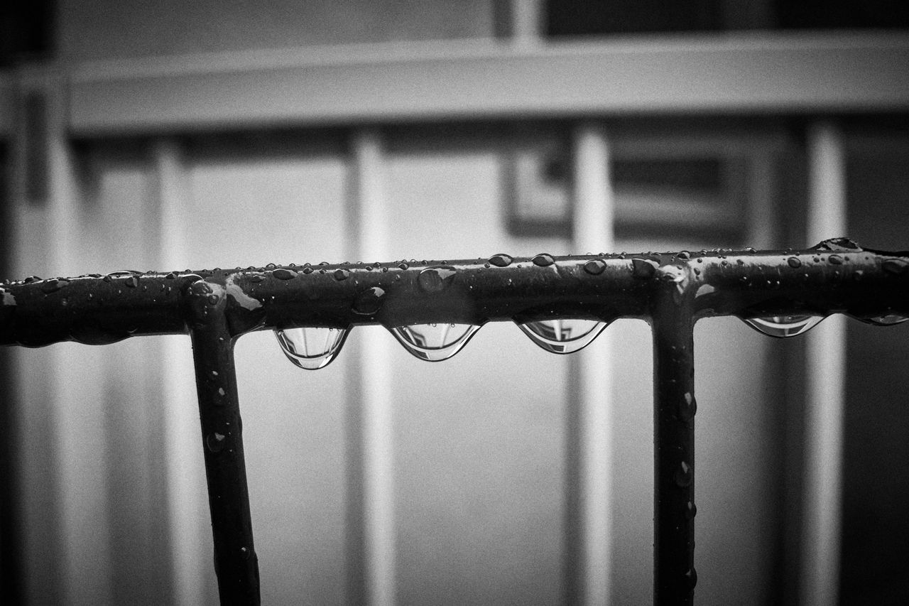 Close-Up Of Water Drops On Railing