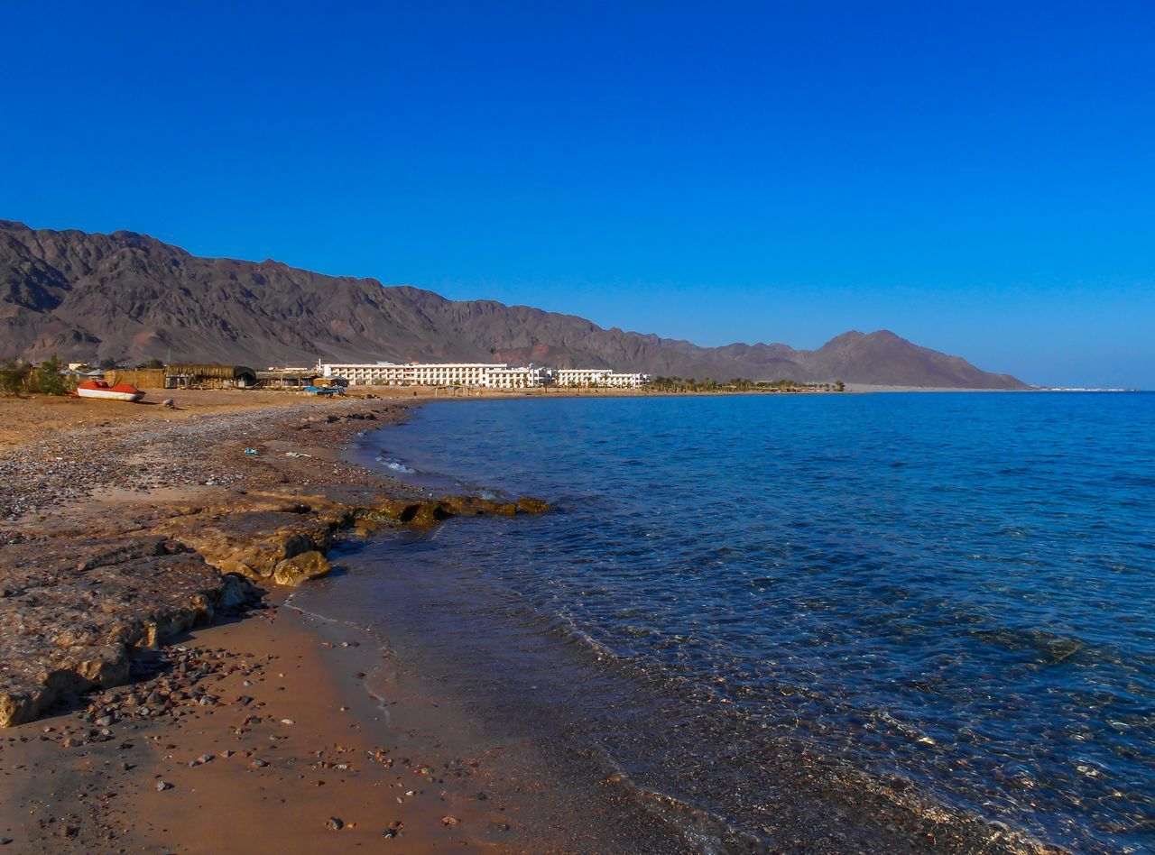 Nuweiba is a coastal town in the eastern part of Sinai Peninsula, Egypt. Located on the coast of the Gulf of Aqaba. Beach Beauty In Nature Blue Blue Sky Day EyeEm Best Shots Gulf Of Aqaba Mountain Nature Nature Nature Photography Naturelovers Nautical Vessel No People Nuweiba Outdoors Reflection Scenics Sky Water