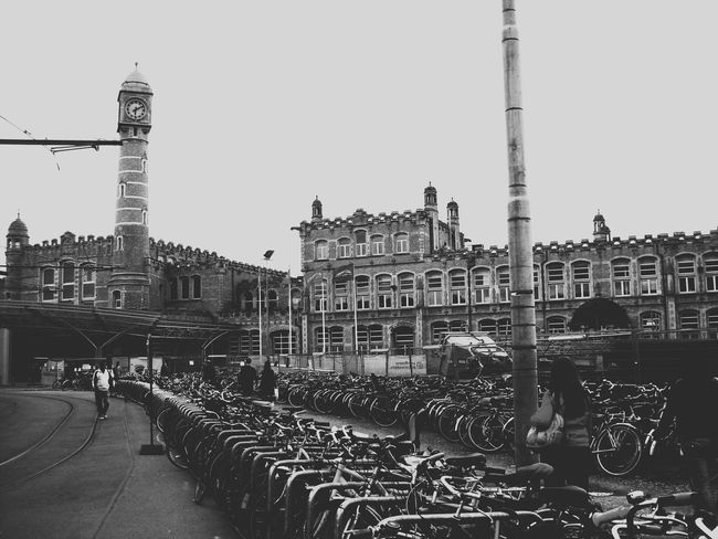 Architecture Black And White Blackandwhite Building Exterior Built Structure Bycicle City City Life Clear Sky Clock Day In A Row Outdoors Real People Tower Tower Clock Travel Destinations