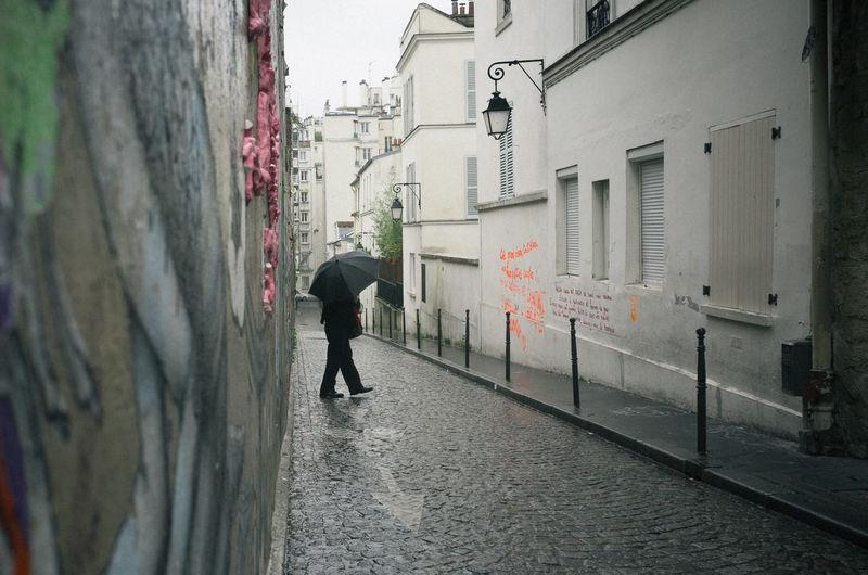 City City Life Color Photography Graffiti Lifestyles Rain Ricoh Gr Streetphotography Umbrella Urban