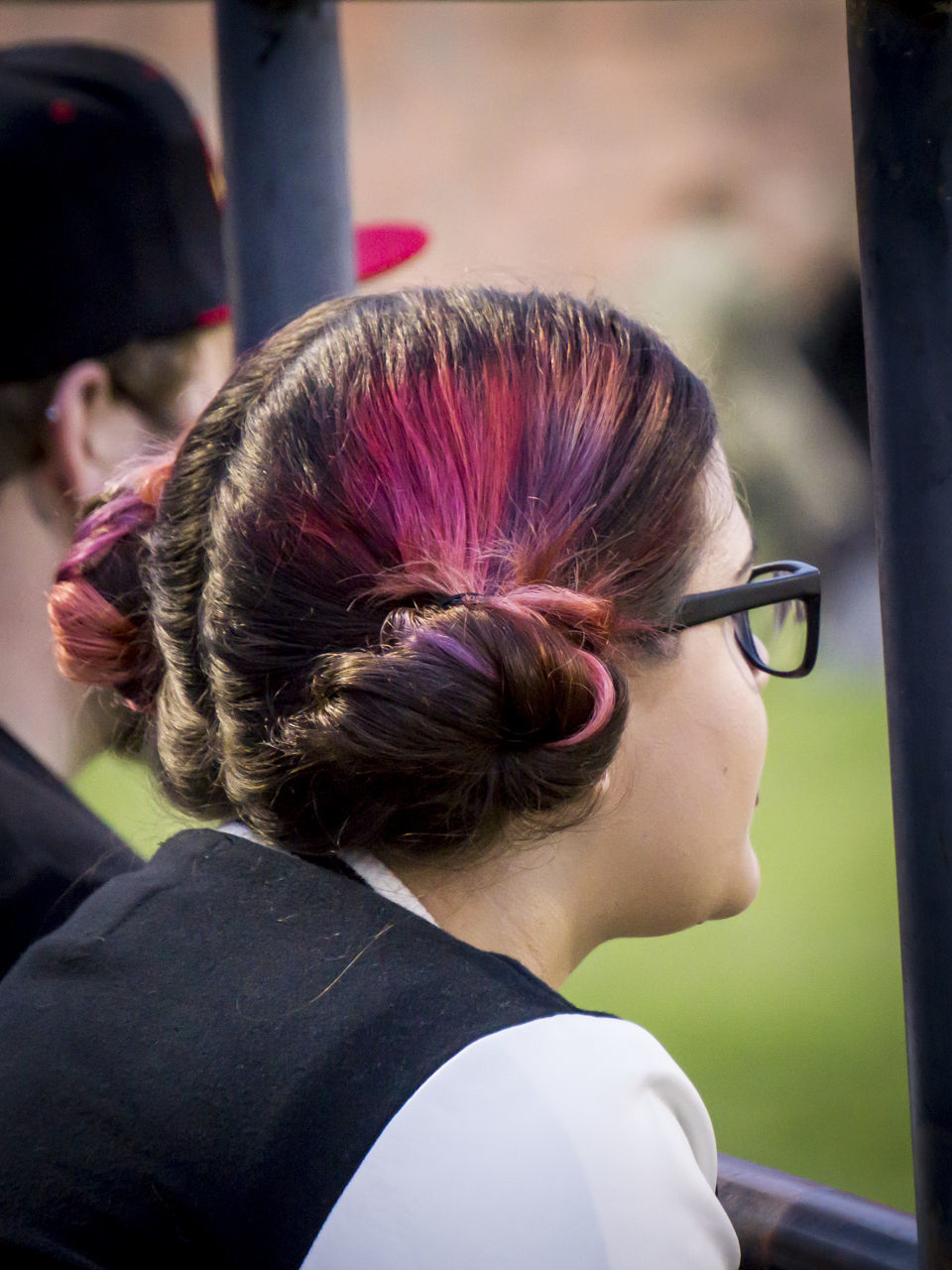 rear view, hair bun, real people, headshot, eyeglasses, one person, outdoors, day, close-up, young adult