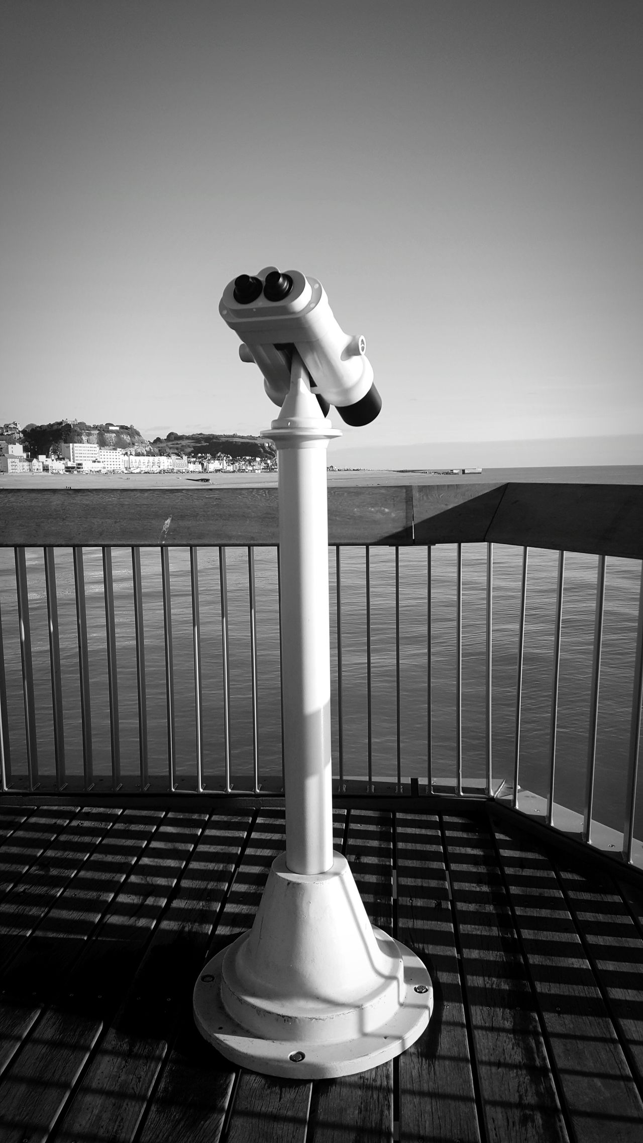 Pier blackandwhite Water Day Coin-operated Binoculars Outdoors Clear Sky Telescope Sky No People Nature Travel Destinations Beach Beauty In Nature Pier Town Spectacular Seaside Railing Horizon Over Water Landscape Coastline Seaside Life Seaside Town Architecture